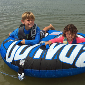 kids having tube towing