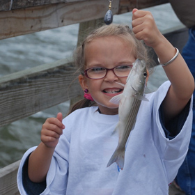 little girl pier fishing